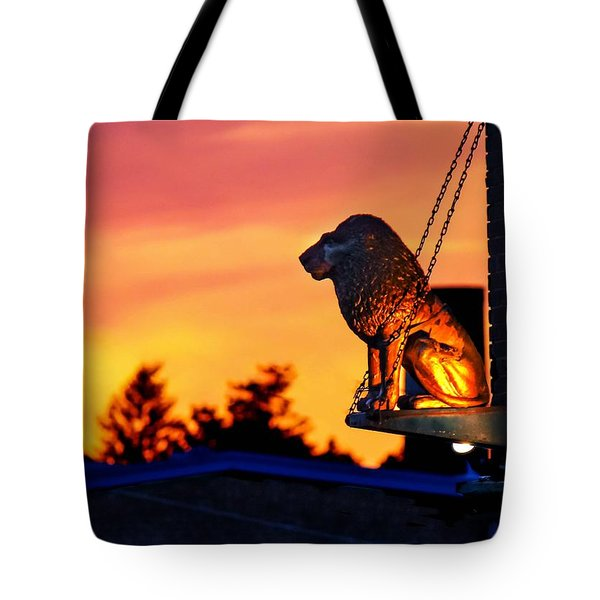 Tote Bag featuring the photograph Brass Cat Lion by Sven Kielhorn