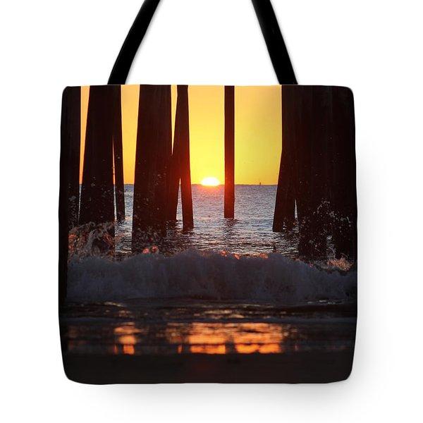Breaking Dawn At The Pier Tote Bag by Robert Banach