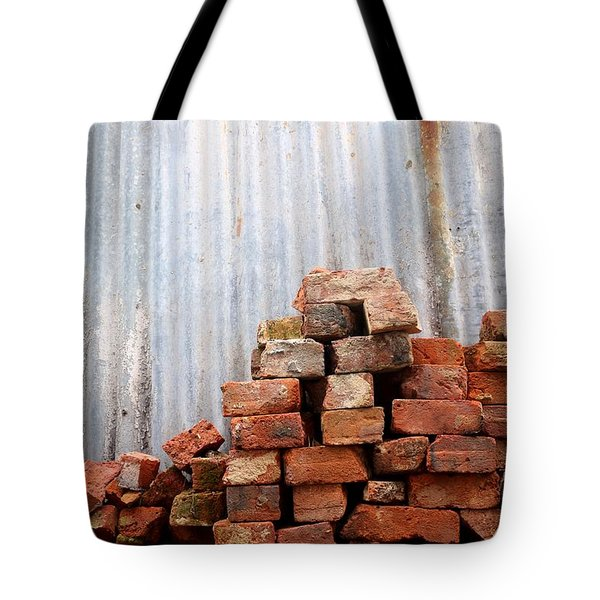 Tote Bag featuring the photograph Brick Piled by Stephen Mitchell