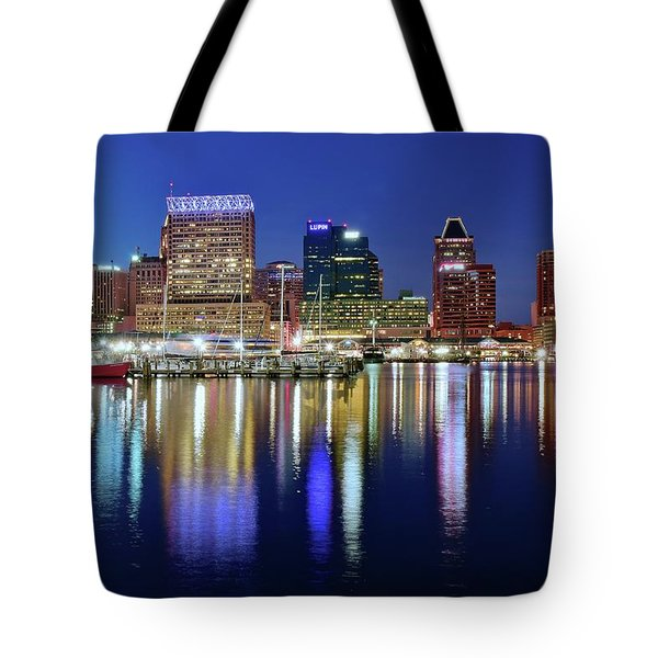 Tote Bag featuring the photograph Bright Blue Baltimore Night by Frozen in Time Fine Art Photography