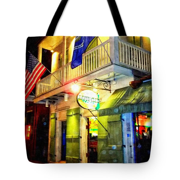 Tote Bag featuring the photograph Bright Lights In The French Quarter by Glenn McCarthy Art and Photography