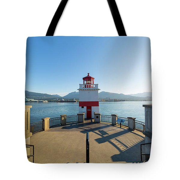 Brockton Point Lighthouse At Stanley Park Tote Bag by David Gn