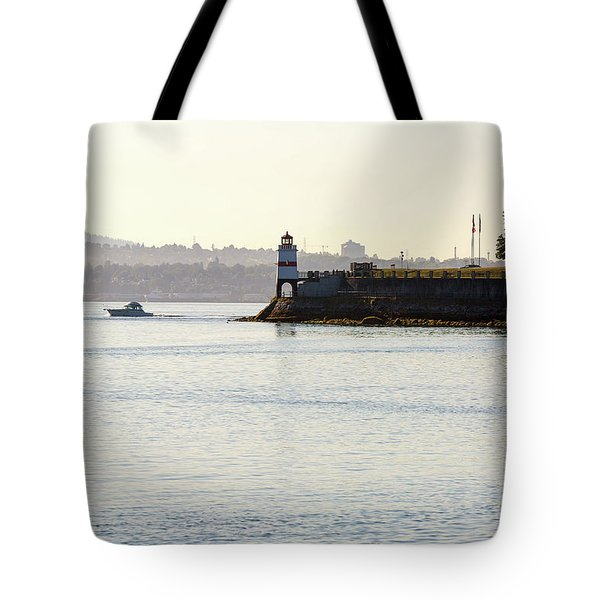 Brockton Point Lighthouse On Peninsula At Stanley Park Tote Bag by David Gn