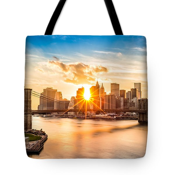 Tote Bag featuring the photograph Brooklyn Bridge And The Lower Manhattan Skyline At Sunset by Mihai Andritoiu