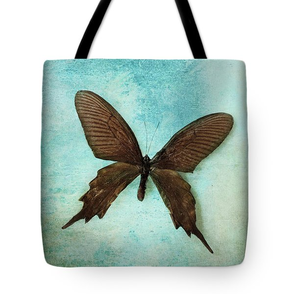 Brown Butterfly Over Blue Textured Background Tote Bag