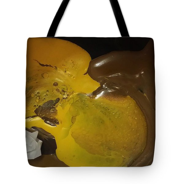 Brown Dolphin Eating A Lemon Tote Bag