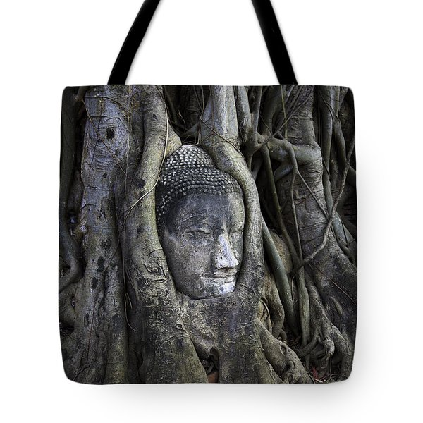 Tote Bag featuring the photograph Buddha Head In Tree by Adrian Evans