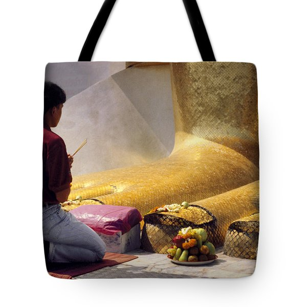 Tote Bag featuring the photograph Buddhist Thai People Praying by Heiko Koehrer-Wagner