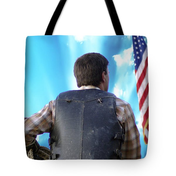 Tote Bag featuring the photograph Bull Rider by Brian Wallace