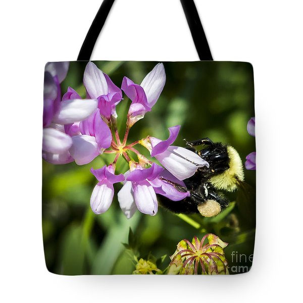 Tote Bag featuring the photograph Bumble Bee Pollinating A Flower by Ricky L Jones
