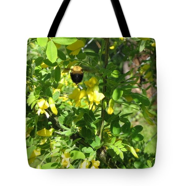 Tote Bag featuring the photograph Bumblebee In Flight In Yellow Flowers by Barbara Yearty