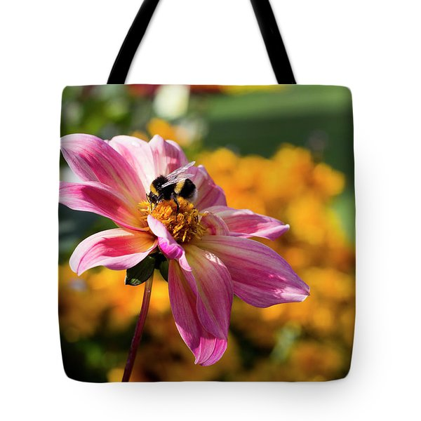 Tote Bag featuring the photograph Bumblebee On Orange by Helga Novelli