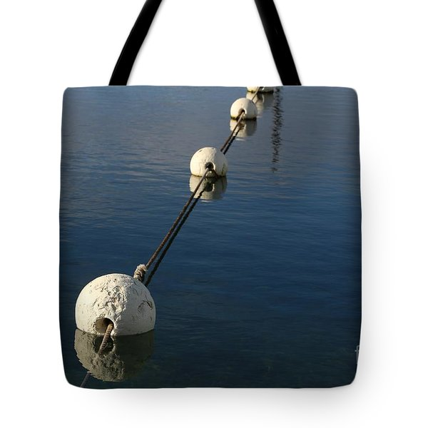 Tote Bag featuring the photograph Buoys In Aligtnment by Stephen Mitchell
