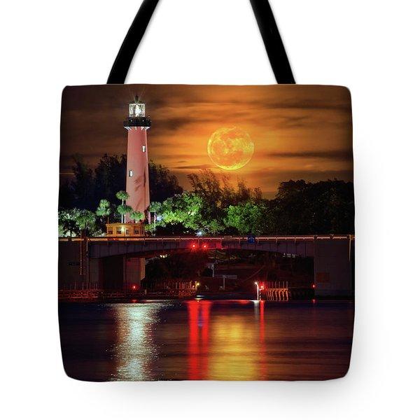 Burning Moon Rising Over Jupiter Lighthouse Tote Bag