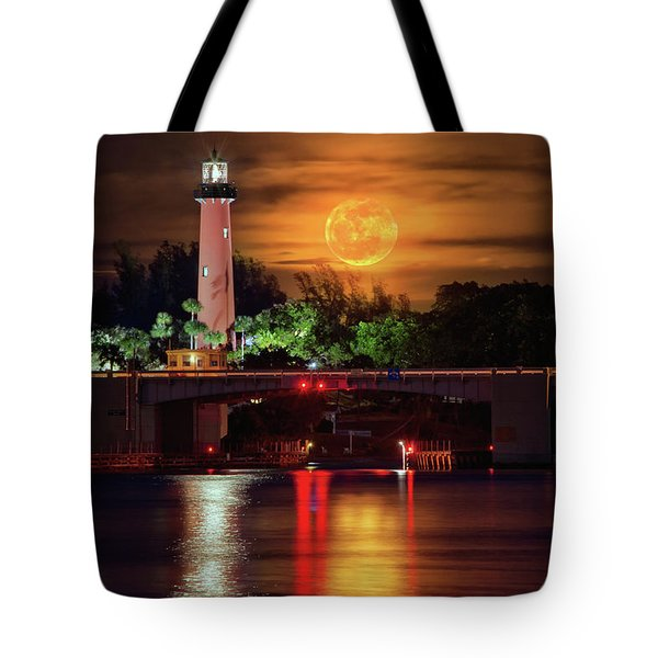 Tote Bag featuring the photograph Burning Moon Rising Over Jupiter Lighthouse by Justin Kelefas