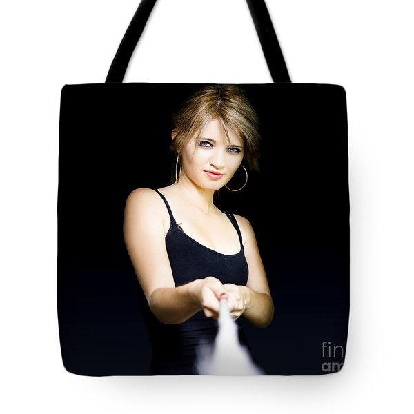 Tote Bag featuring the photograph Business Person Pulling Rope In Tug Of War Concept by Jorgo Photography - Wall Art Gallery