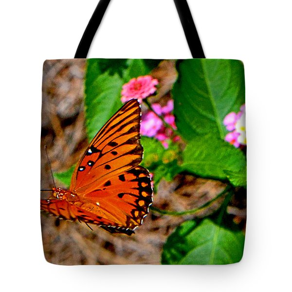 Tote Bag featuring the photograph Butterfly In Flight 002 by George Bostian