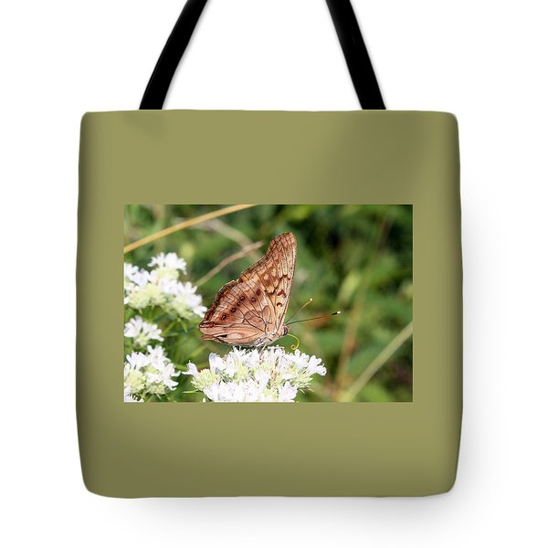 Tote Bag featuring the photograph Butterfly On White Flowers by Ellen Tully