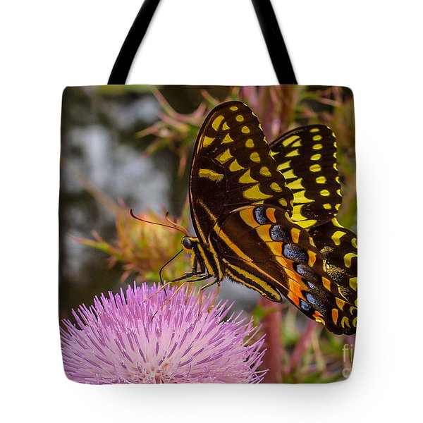 Tote Bag featuring the photograph Butterfly Visit by Tom Claud