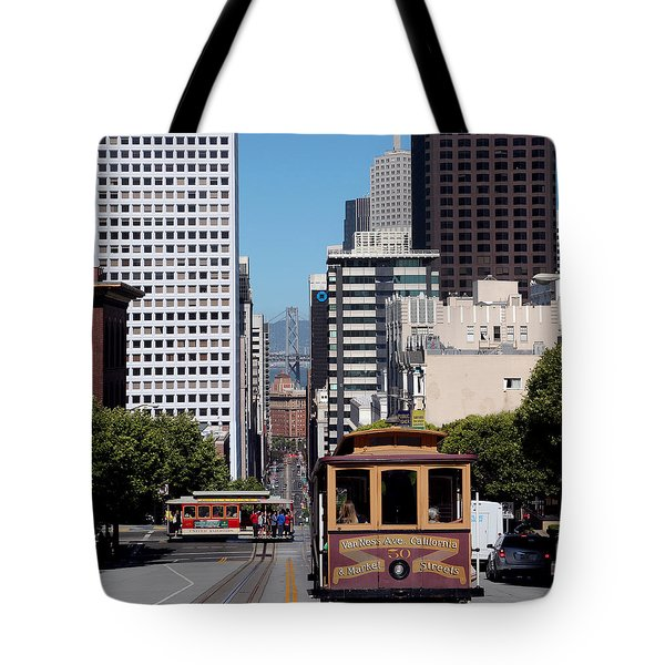 Cable Cars Crossing In San Francisco Tote Bag by Wernher Krutein