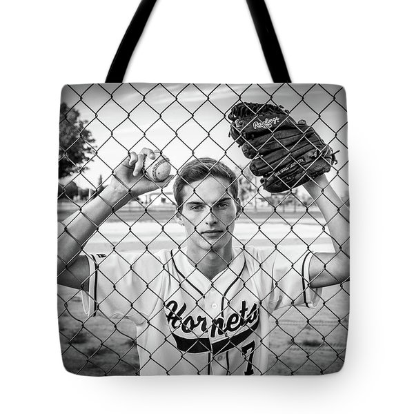 Tote Bag featuring the photograph Caged Competitor by Bill Pevlor