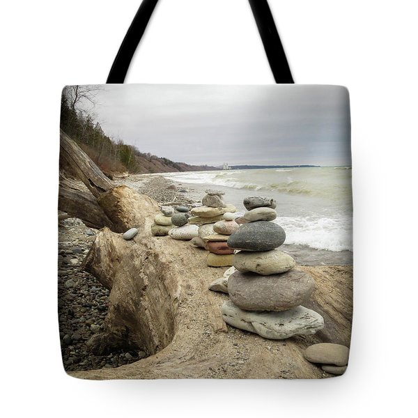 Tote Bag featuring the photograph Cairn On The Beach by Kimberly Mackowski