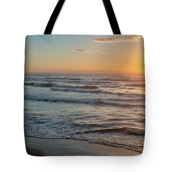 Calm Water Over Wet Sand During Sunrise Tote Bag