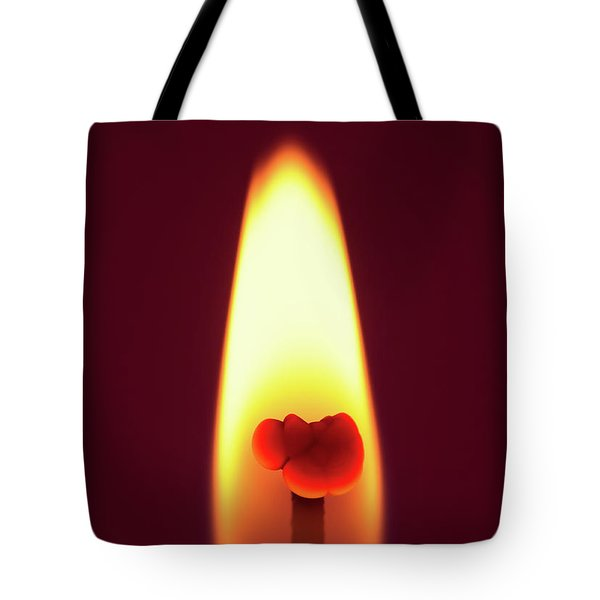 Candle Flame Macro Tote Bag by Wim Lanclus