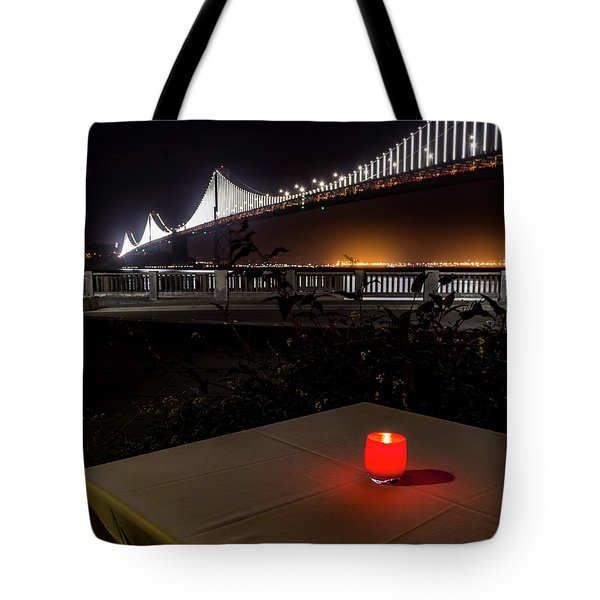 Tote Bag featuring the photograph Candle Lit Table Under The Bridge by Darcy Michaelchuk
