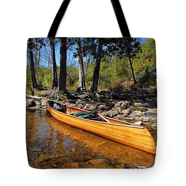 Canoe At Portage Landing Tote Bag by Larry Ricker