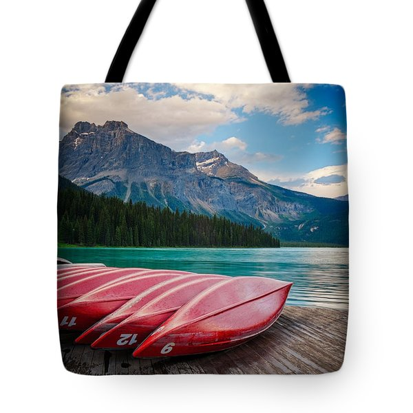 Tote Bag featuring the photograph Canoes At Emerald Lake In Yoho National Park by Bryan Mullennix
