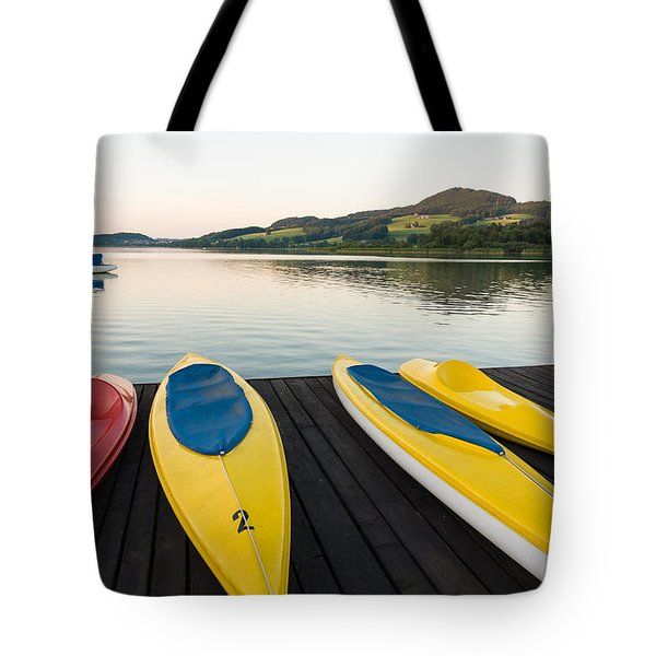 Canoes On Pier In A Tranquil Afternoon Tote Bag
