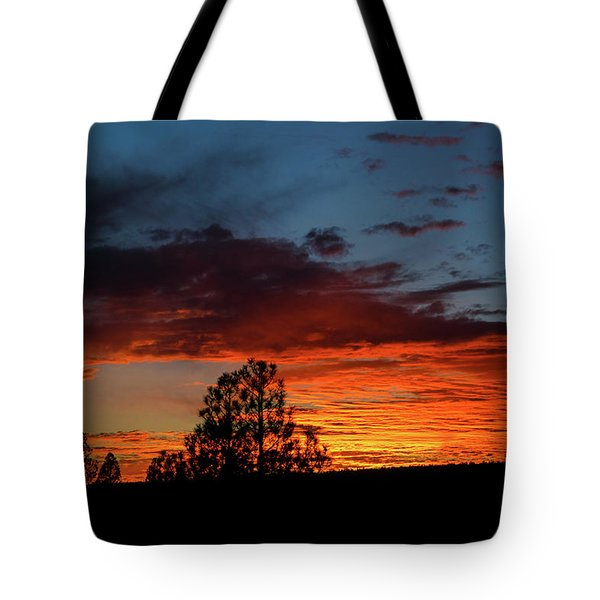 Tote Bag featuring the photograph Canvas For A Setting Sun by Jason Coward