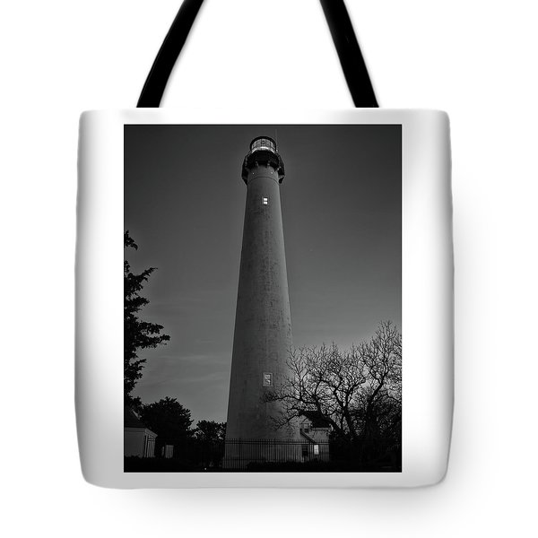 Tote Bag featuring the photograph Cape May Lighthouse In Evening Bw by Kristia Adams