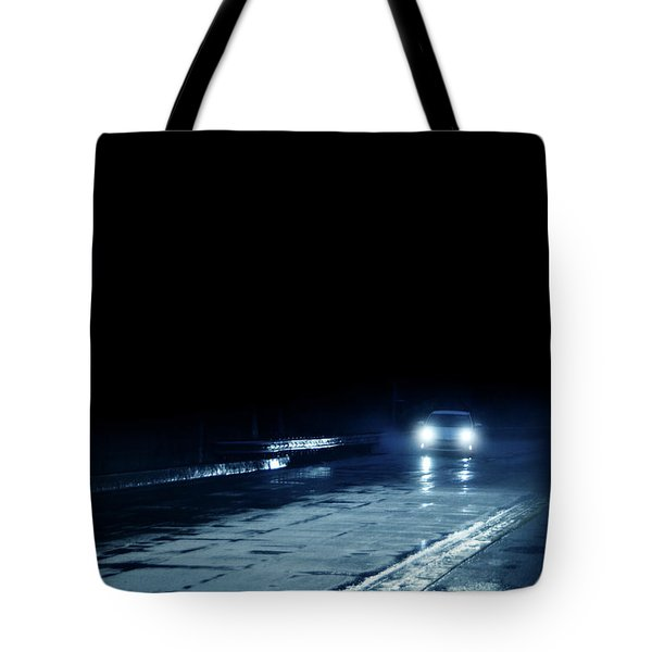 Car On A Rainy Highway At Night Tote Bag by Jill Battaglia