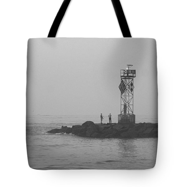 Tote Bag featuring the photograph Casting At The Inlet Jetty by Robert Banach
