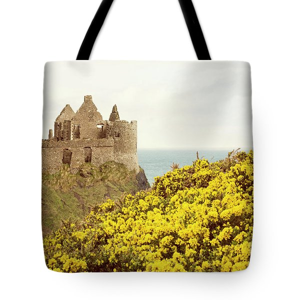 Tote Bag featuring the photograph Castle Ruins And Yellow Wildflowers Along The Irish Coast by Juli Scalzi