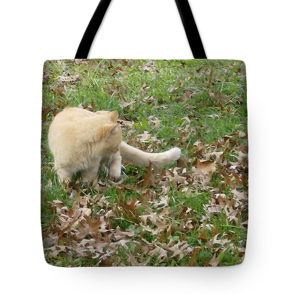 Tote Bag featuring the photograph Cat Playing In The Leaves by Skyler Tipton