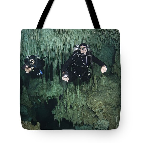Cave Divers In Dreamgate Cave System Tote Bag by Karen Doody