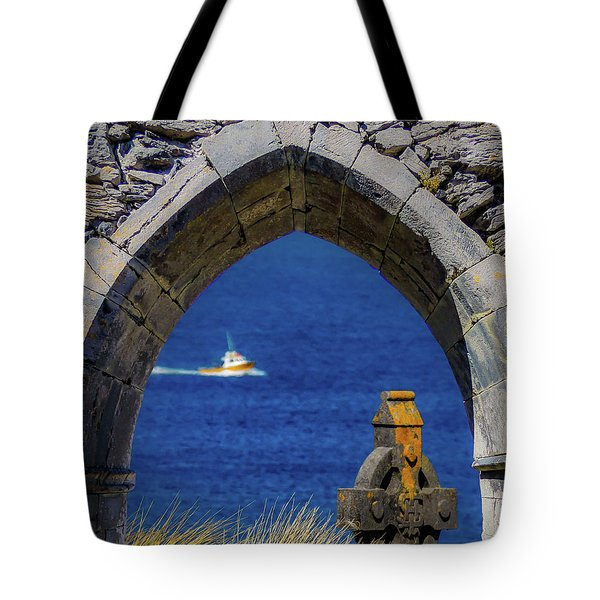 Tote Bag featuring the photograph Celtic Cross And Fishing Vessel From Isle Of Inisheer by James Truett