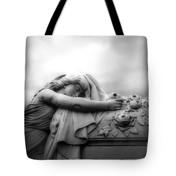 Tote Bag featuring the photograph Cemetery Grave Mourner Black White Surreal Coffin Grave Art - Angel Mourner Across Rose Coffin by Kathy Fornal