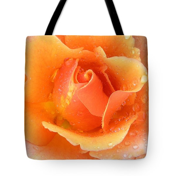 Center Of Orange Rose Tote Bag by John Lautermilch