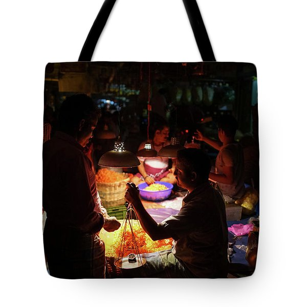 Tote Bag featuring the photograph Chennai Flower Market Transaction by Mike Reid