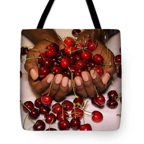 Tote Bag featuring the photograph Cherry In The Hands by Paul SEQUENCE Ferguson             sequence dot net