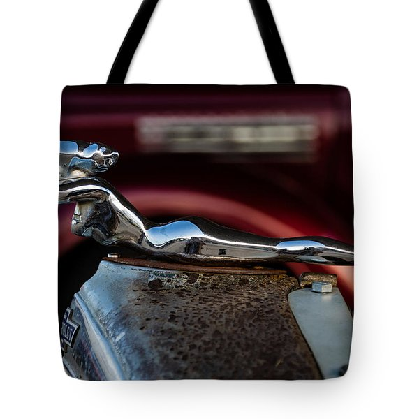 Tote Bag featuring the photograph Chevrolet Hood Ornament by Jay Stockhaus