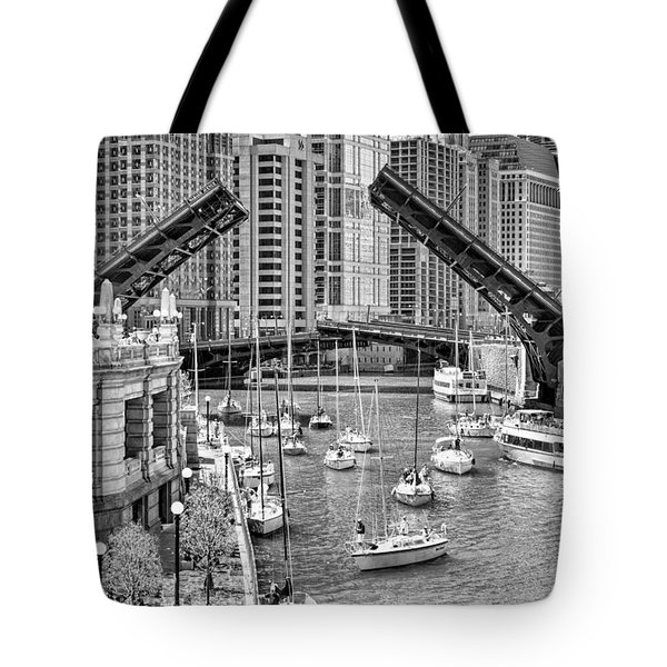 Tote Bag featuring the photograph Chicago River Boat Migration In Black And White by Christopher Arndt