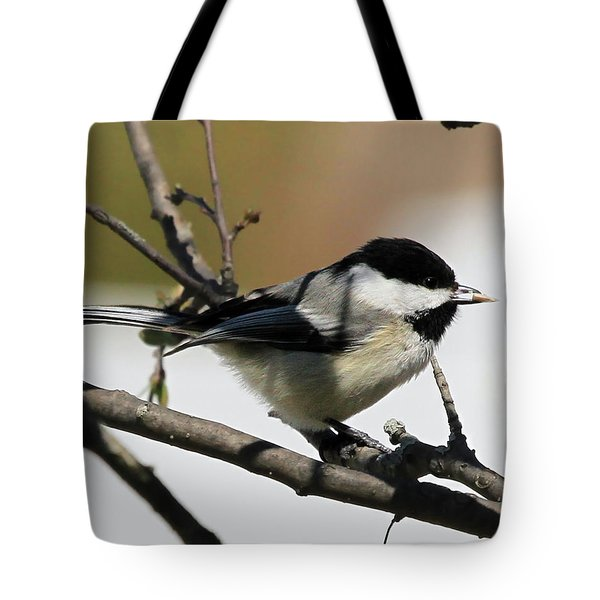 Tote Bag featuring the photograph Chickadee With A Sunflower Seed by Jackson Pearson