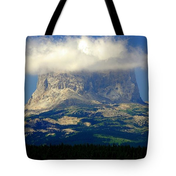 Chief Mountain, With Its Head In The Clouds Tote Bag
