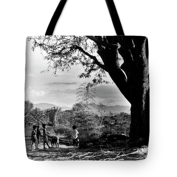 Tote Bag featuring the photograph Children Of Central Highland Are Playing With A Dog by Silva Wischeropp