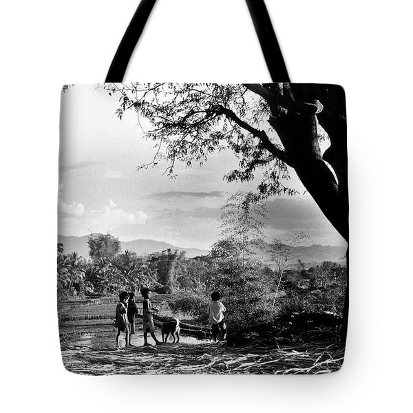 Children Of Central Highland Are Playing With A Dog Tote Bag